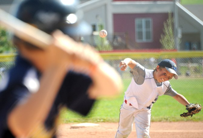 Davis Petersen unleashes a pitch during a 2011 Triple Crown tournament game in Steamboat Springs. The city's Parks and Recreation Commission next week will talk about an idea of allowing Triple Crown to expand to the ballfields at Emerald Park.