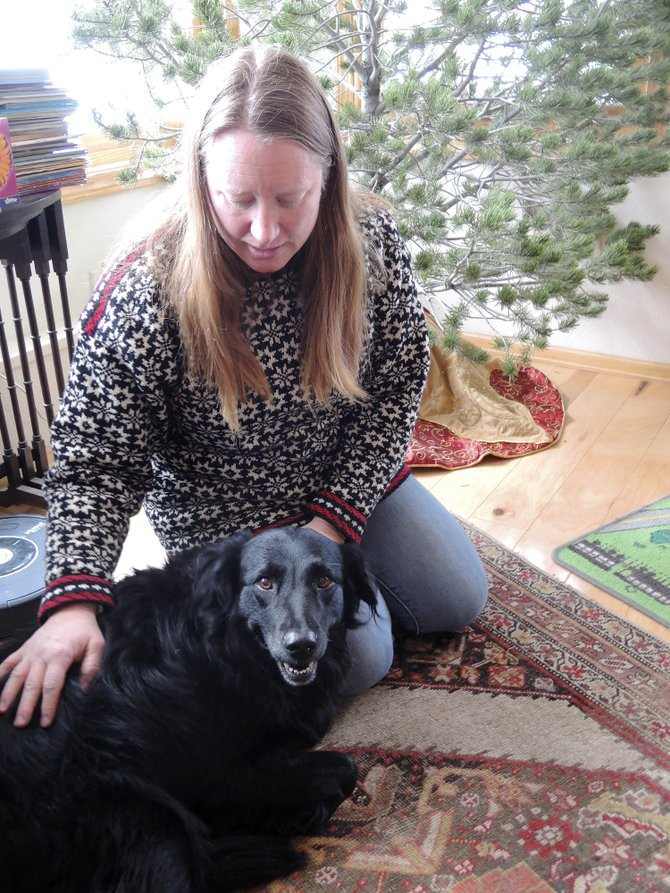 Steamboat Springs resident Winnie DelliQuadri pets her dog Hailey, who is suspected of having ingested marijuana while being walked in a downtown park. Hailey had a bad reaction to the drug, and DelliQuadri is hoping her pet recovers.
