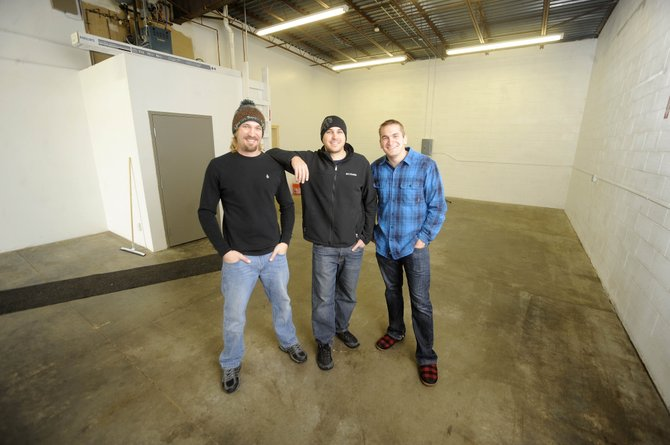 Storm Peak Brewing Co.'s 2,050-square-foot building will have a capacity of 65 people and will feature tables on one side of the building and a bar on the other. Pictured are, from left, Tyler Patterson, Zach Patterson and Wyatt Patterson.