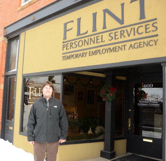 C.J. Skowronski stands outside Flint Personnel Services, where the Craig man has dedicated himself to making a difference in the lives of those in need.