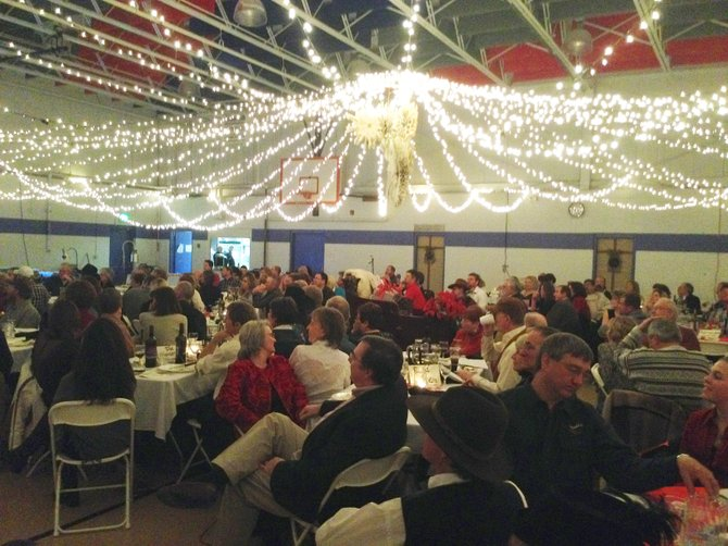 The crowd at Saturday's Cowboy Christmas sits down to dinner at the Boys & Girls Club of Craig. About 275 people turned out for the annual event, which included dancing, live music, auctions and the naming of People of the Year.