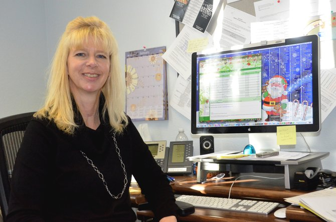 Vicki Haddan takes a break from working on her Christmas-themed computer desktop. Haddan has worked in many roles in the Moffat County School District for nearly 20 years, currently as the administrative assistant to Superintendent Joe Petrone.
