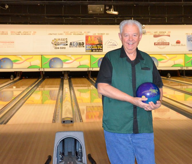 Les Shirkey stands in front of the lanes where he bowled his fourth 300 at Thunder Rolls Bowling Alley last Friday. He also posted a record series for the Craig lanes of 827.