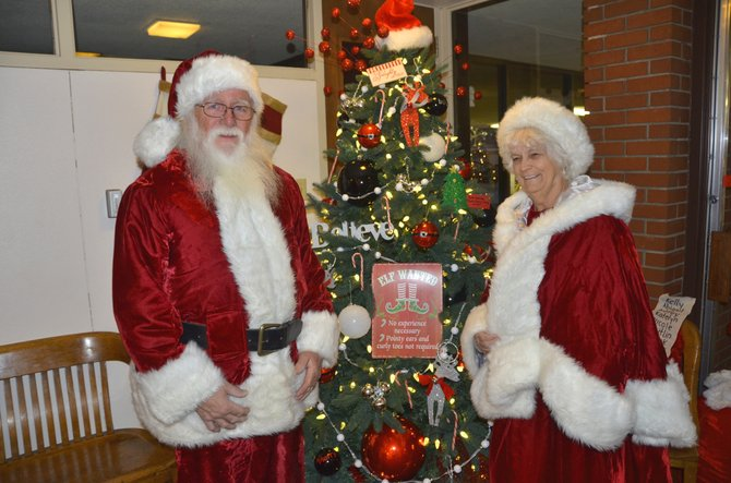 Santa and Mrs. Claus enjoy the decorations and good will during the Festival of Trees at the Moffat County Courthouse. They will be appearing there Thursday, as well as many other local spots leading up to Christmas Eve.