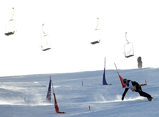 Winston Vaughan carves it up high on Howelsen Hill on Sunday afternoon in Steamboat Springs. The downtown hill played host to a USASA snowboard event. Vaughn was second in his division in the slalom and giant slalom courses.