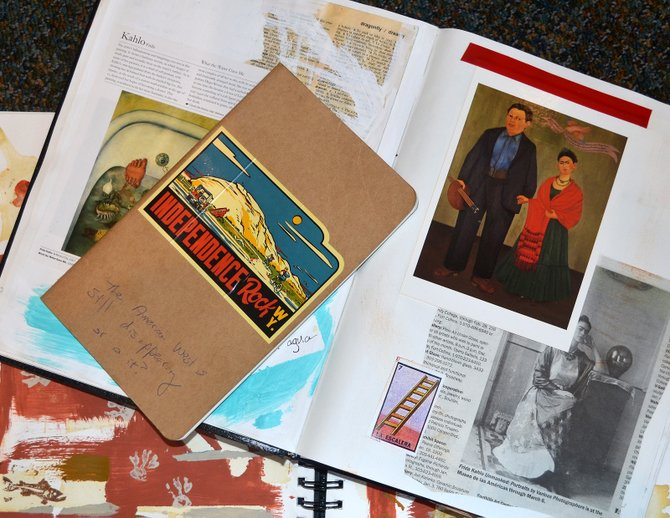 Visual notebooks may take many forms. The Sketchbook Project being facilitated by Bud Werner Memorial Library is using small, unlined Moleskine notebooks not unlike the smaller of the journals in this photograph.