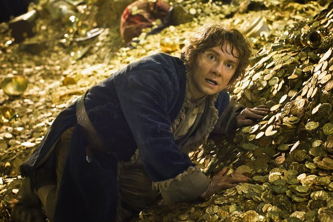 "Bilbo Baggins (Martin Freeman) struggles to keep his footing atop the mounds of treasure in a dragon's lair in ""The Hobbit: The Desolation of Smaug."" The movie is the second of the three-part adaptation of J.R.R. Tolkien's fantasy about Middle-earth."