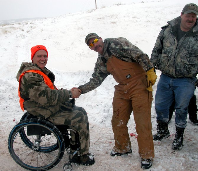 Butch Martin, of Fishers, Ind., hangs out with Shawn Polley and Rob Sovine, employees at Trapper Mining Inc. Polley and Sovine went on a hunt with Martin through Outdoor Buddies Inc., which gives disabled and mobility-impaired outdoors enthusiasts the chance to get back outside and enjoying their favorite activities. Martin, a wheelchair-bound man after an industrial accident, harvested a cow elk on his trip to Craig.