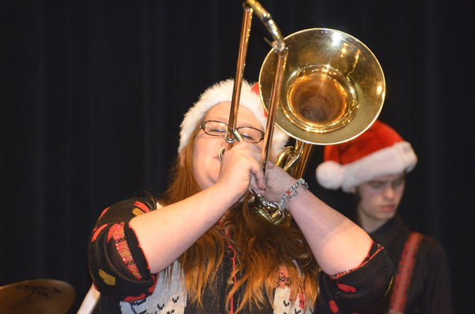 "Moffat County High School sophomore Veronica Mead plays a trombone solo of Wayne Shorter's ""Footprints"" during the MCHS Winter Concert Tuesday night. The Symphonic and Jazz Bands were featured during the performance, while members of Craig Middle School band played their own show Thursday night."