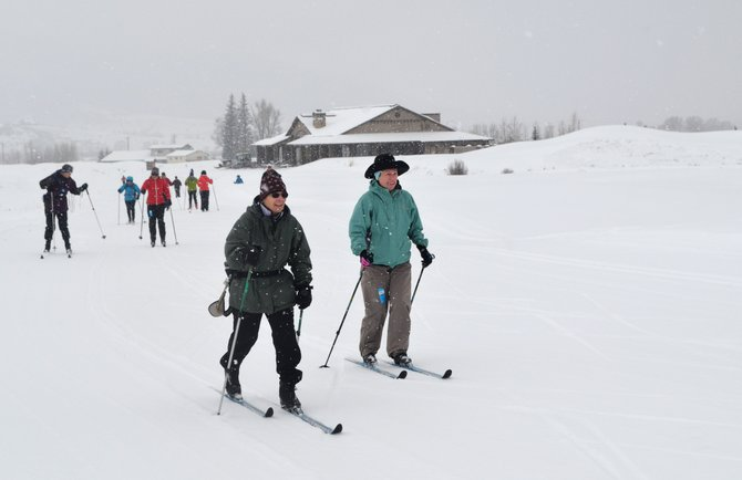 Elaine Kopf, left, and Barbara Flowers lead a group of 13 local women onto the gentle Fox Tail loop on a snowy Friday morning at the new Haymaker Nordic Clubhouse.
