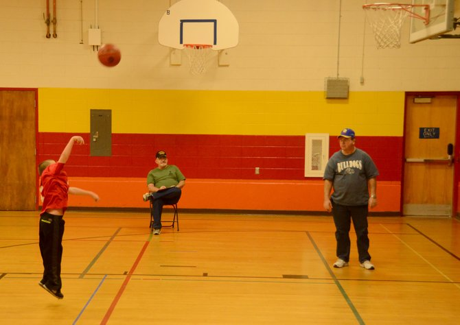 Tanner Dugan puts up a foul shot from the 12-foot line used by the 8-9 year-old age groups at the Elks Lodge Hoop Shoot Saturday at Sandrock Elementary.