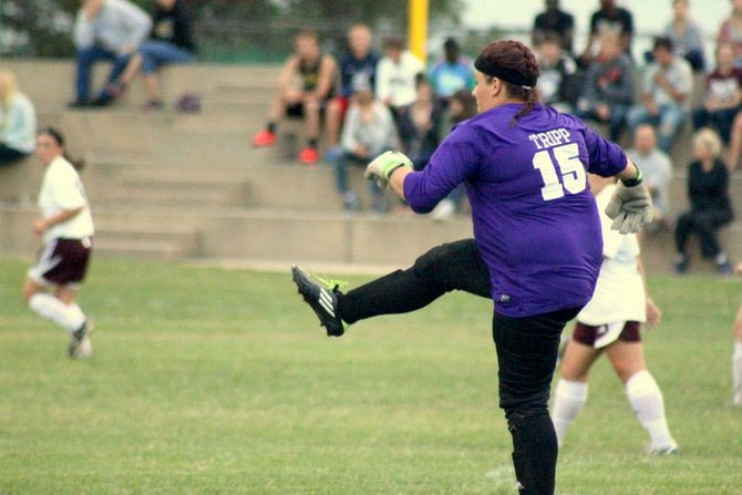 Skylar Tripp kicks the ball away from the Hesston defensive zone during a game last fall. Tripp, a 2013 Moffat County High School graduate, had the second-most saves in a single season in Hesston women's soccer history during her freshman year with the Larks.