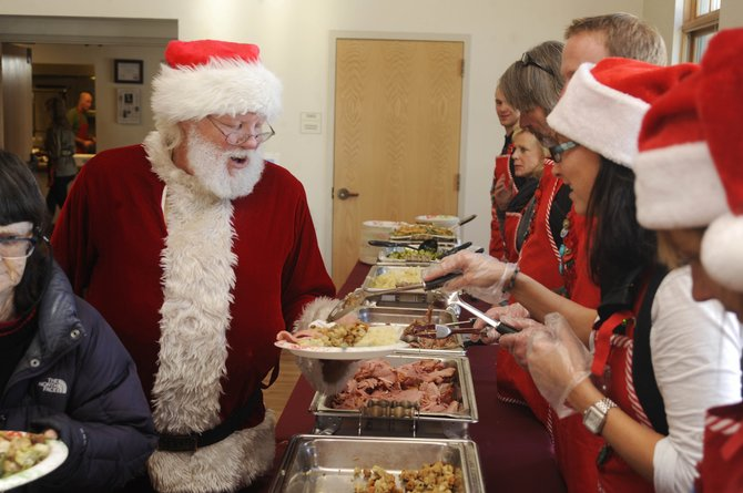 Former longtime Steamboat Springs resident Robert Sawer fills his plate Wednesday during the Community Christmas Dinner at the Steamboat Springs Community Center.