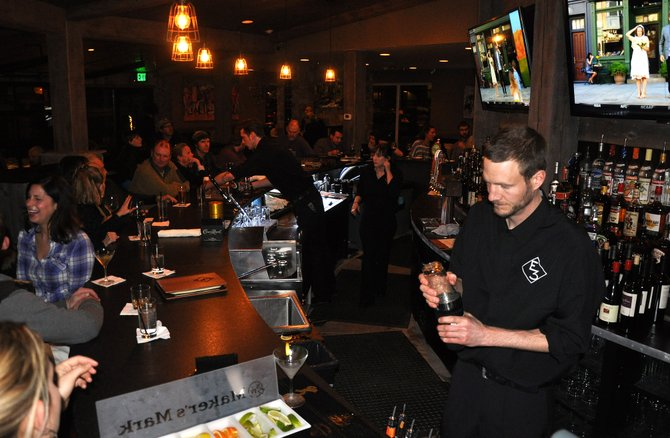 Bartenders make drinks for a big crowd on opening night at the new E3 Chophouse in downtown Steamboat Springs.