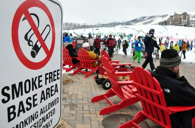 "A sign advises skiers at Steamboat Ski Area of its no smoking policy at the base of Mount Werner. Public Safety Director Joel Rae said there will be no ""grace period"" for people who are caught smoking newly legalized marijuana in public."