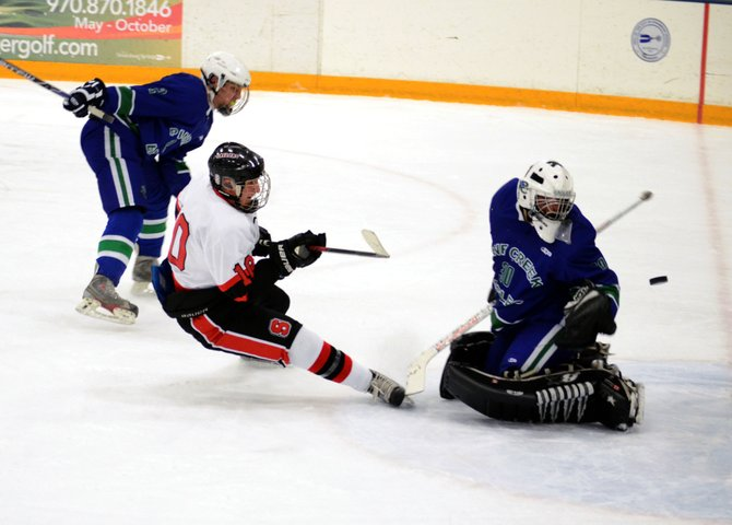 Sailors captain Ben Wharton slides a shot past the Pine Creek goalie in the first period of Friday night's win, but officials overruled the score in a controversial call.