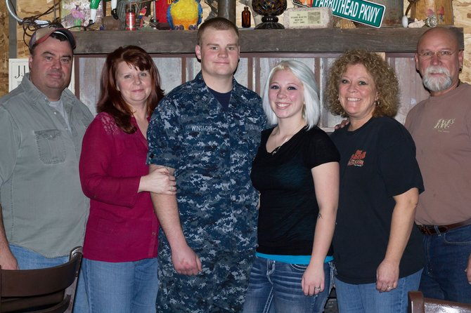 Jeff Winlsow, left, Larri Winslow, Ben Winslow, Carli Winslow, Teri Griffith, Danny Griffith pose as a family. Ben leaves for his first deployment to the Middle East in February. The 20-year-old Craig native is an aviation mechanic for the Navy and currently is stationed in Virginia Beach with his wife, Carli.
