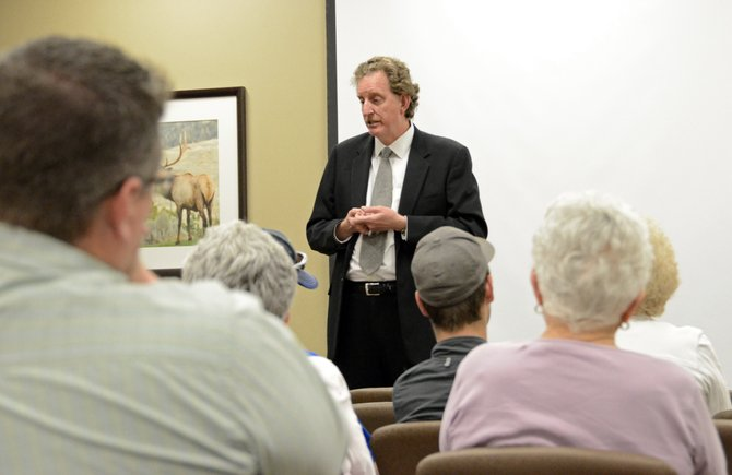 Chris Smolik, who announced his resignation as CEO of The Memorial Hospital today, speaks with community members in May 2013 as a finalist for the job.