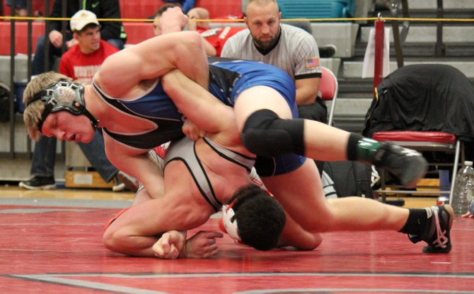 Jesse Demoor wrestles at the Warrior Classic in December. The Moffat County senior took third place in the 182-pound division at the Warrior and will have his first opportunity to wrestle in front of a home crowd this season. MCHS hosts Hayden on Thursday.