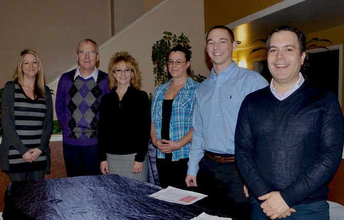 Clarion Inn & Suites new owner Sholom Jacobs, right, stands with staff at the hotel's meet and greet Wednesday night. From left, Shawnna Muhme, Tom French, Vicki Wade, Jennifer Harring, Zac Weiner and Jacobs.