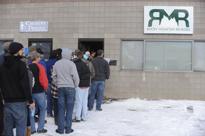 Customers wait in line Wednesday morning outside Rocky Mountain Remedies.