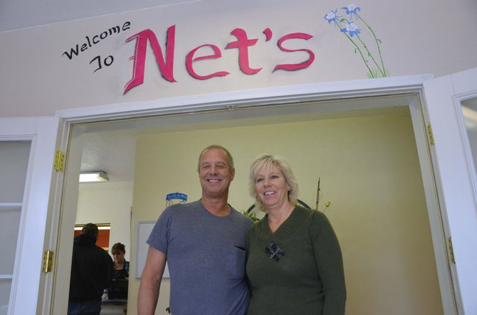 George, left, and Jeanette Bosick greet customers in the entryway of their Maybell restaurant, Net's Cafe. The eatery will temporarily shift to winter hours through February, as the owners expect to see more customers once spring starts.