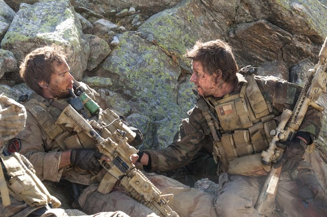 "Navy SEALs Michael P. Murphy (Taylor Kitsch) and Marcus Luttrell (Mark Wahlberg) try to formulate a plan while under fire in ""Lone Survivor."" The movie is about Navy SEAL Team 10's failed 2005 mission to capture and kill a Taliban leader in Afghanistan."
