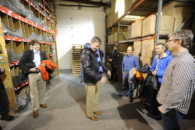 Colorado Gov. John Hickenlooper tries on his new Big Agnes coat during a tour of the Steamboat Springs company's warehouse Saturday morning.