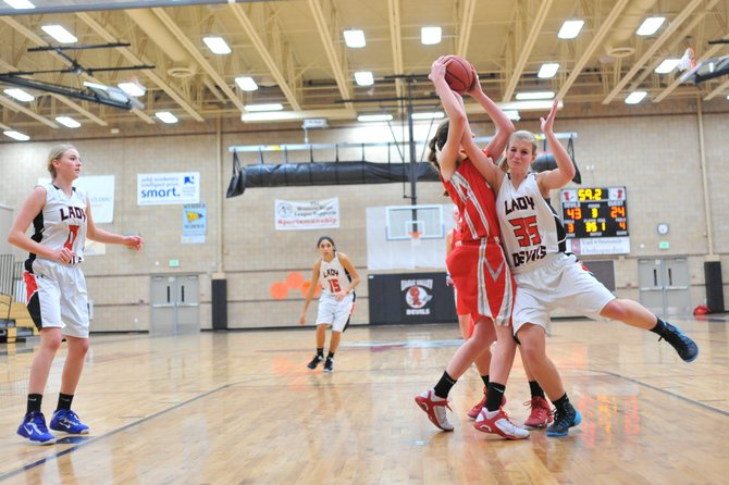 Steamboat's Annie Osbourn steals the ball from Eagle Valley's Jessie Chambers in the third quarter Thursday in Gypsum. Eagle Valley went on to win, 49-34.
