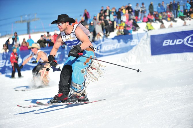 Clint Cannon, a bareback rider from Waller, Texas, showed the crowd at the 39th annual Bud Light Cowboy Downhill just how tough he was by making his run without a shirt Monday afternoon. The annual event is back in Steamboat for its 40th year starting at 1 p.m. Monday.