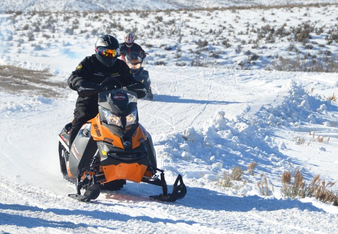 JR Mckelvy gets on his way Saturday morning at the Freeman Reservoir Trailhead. Mckelvy was participating in his first Northwest Colorado Snowmobile Club Poker Run, which had a near-record number of riders on a 40-mile round trip on the snowmobile trails north of Craig.