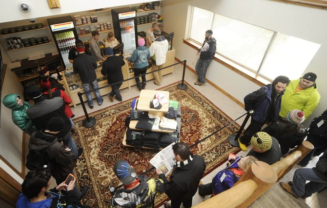 Customers line up inside Rocky Mountain Remedies on its first day of recreational marijuana sales. Many local teenagers are wondering how they will be affected by the sale of retail pot in Steamboat Springs, and Grand Futures Prevention Coalition is working as hard as ever to make sure youths stay drug free.