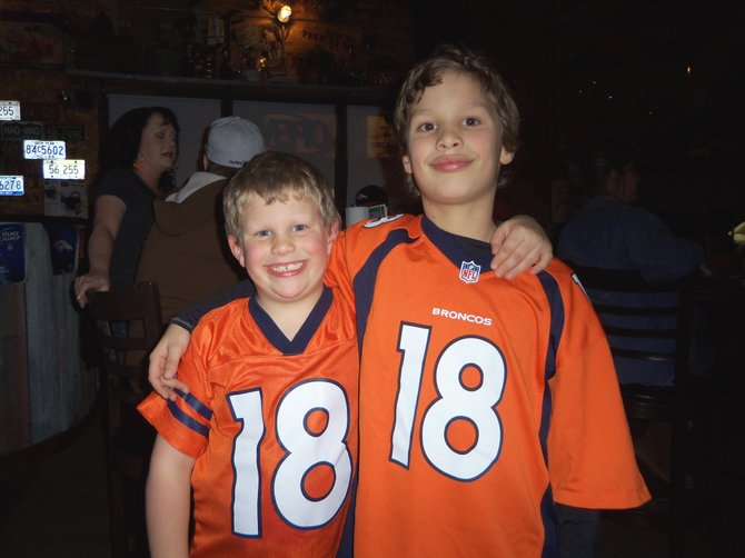 Brothers Bennett, left, and Steven Powell, ages 6 and 9, are all smiles following the Denver Broncos' victory Sunday afternoon against the New England Patriots. Residents of Northwest Colorado and the rest of the state were cheering on the Broncos as they played for the AFC championship and a slot in Super Bowl XLVIII.