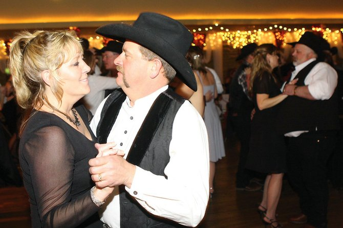 Carlene and Jeremy Sanders sway on the dance floor during the Craig Rotary Club's 2010 Diamonds & Spurs fundraiser. This year's event will take place at 6 p.m. Saturday at the Moffat County Fairgrounds Pavilion.