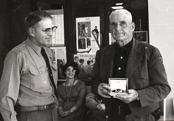 In this 1964 Craig Daily Press photo, George Krieger, right, who served Moffat County and Craig in law enforcement for 27 years, holds the watch presented to him by Sheriff Bob Gadd. Krieger served as Moffat County sheriff for 18 years, then went on to work with the Craig Police Department for an additional nine years before his retirement at age 76.
