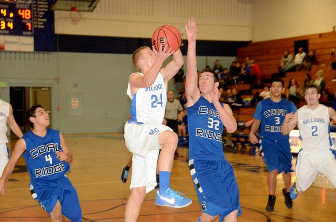 Tyler Davis goes to the hoop in the fourth quarter Friday in Craig. Davis scored 12 points for Moffat County as it beat Coal Ridge at home, 70-51.