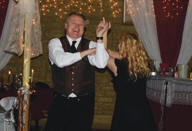 Wayne and Janet Wright do a triple step to the music at the 15th annual Diamonds & Spurs at the Moffat County Fairgrounds Pavilion.