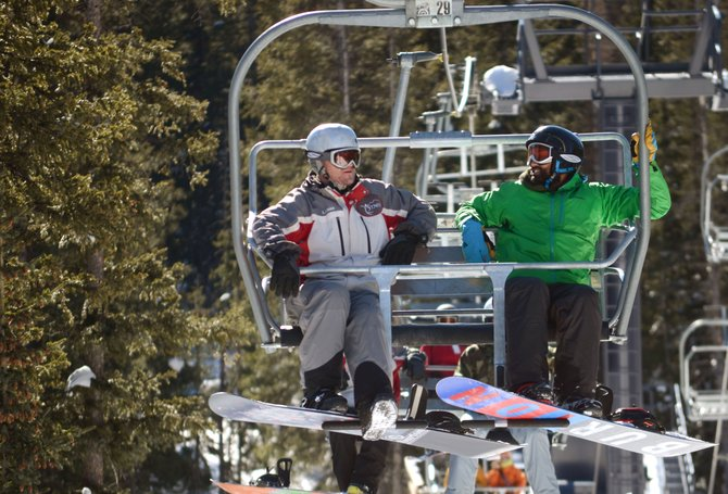 Chris Chatwin, right, and his weekend guide Brian Autry ride the Morningside chairlift Sunday at Steamboat Ski Area. Chatwin was one of many wounded warriors participating in the second annual STARS & Stripes Heroes Camp.