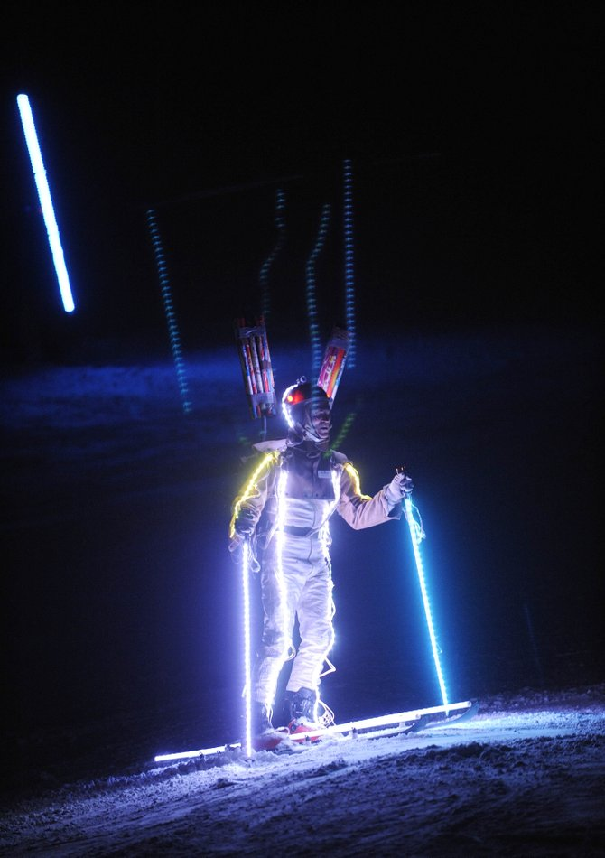 The Lighted Man comes down Howelsen Hill during the 2013 Winter Carnival Night Extravaganza.