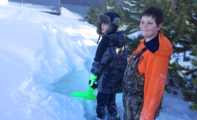 Ridgeview Elementary third-grader Jayce Christopher, left, and fourth-grader Alec Tucker dig out a snow cave as part of a project on winter survival. The two were part of a group of 20 students who attended a science field trip to Granby's Snow Mountain Ranch with YMCA of the Rockies.