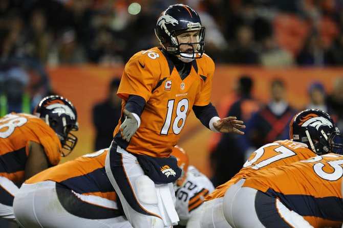 Denver Broncos quarterback Peyton Manning prepares for a snap in a 2012 game. Gov. John Hickenlooper honored Manning and his teammates recently by naming mountains within the Colorado 14ers after players on the roster. The temporary name changes will be in effect only for Super Bowl Sunday, when the AFC Championship team will play the Seattle Seahawks.