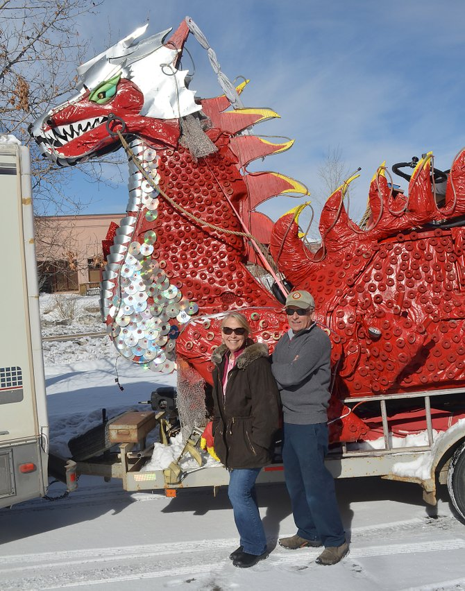 Steamboat residents Gail and Charlie Holthausen loaded Spike the Big Red Dragon onto a flatbed trailer Tuesday and pointed their motorhome west to Los Angeles and Spike's new home. The dragon car, which breathed flames, had become a fixture at local street events, including Merry Mainstreet and the annual Halloween Stroll.