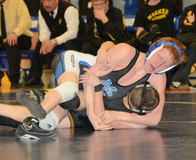 Moffat County's Issik Herod works for pin position Tuesday in Craig. The Bulldogs wrestled again Thursday in Parachute, beating Basalt and Grand Valley before losing to Cedaredge in their three duals.