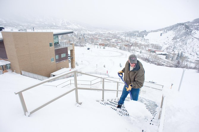 Willie Samuelson, a maintenance worker at Colorado Mountain College's Alpine Campus, clears snow from a stairway leading to the college's academic center. Several flights destined for Yampa Valley Regional Airport on Thursday were diverted, canceled or delayed by midday, but it may not have been the snowstorm in Northwest Colorado that caused the travel issues.