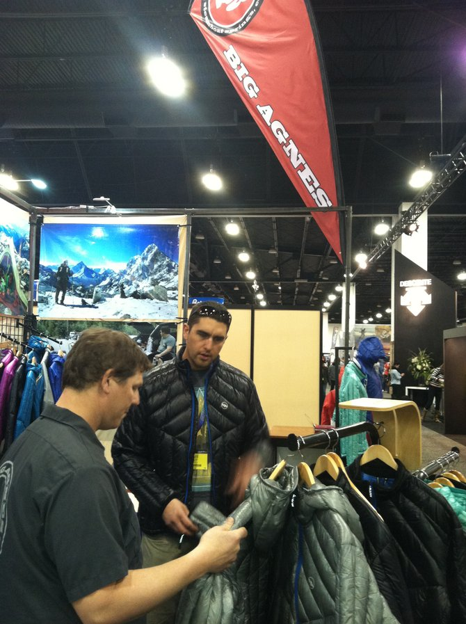 Big Agnes' Chris Daniels walking a retailer through the line at the Snowsports Industries America Snow Show in Denver.