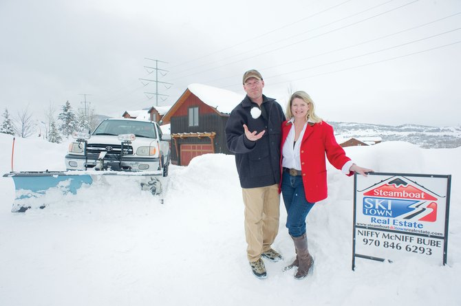 Chris, left, and Niffy McNiff Bube have been building their own type of do-it-all real estate business in Routt County for the past couple of years with Steamboat Ski Town Real Estate.
