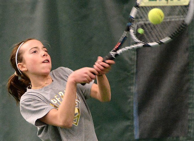 Tatum Burger plays Sunday at the Tennis Center at Steamboat Springs. She ran into younger brother Teague in the finals and won in a thrilling third-set tiebreaker.