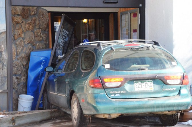 An elderly woman crashed her car into Craig City Hall Monday afternoon.