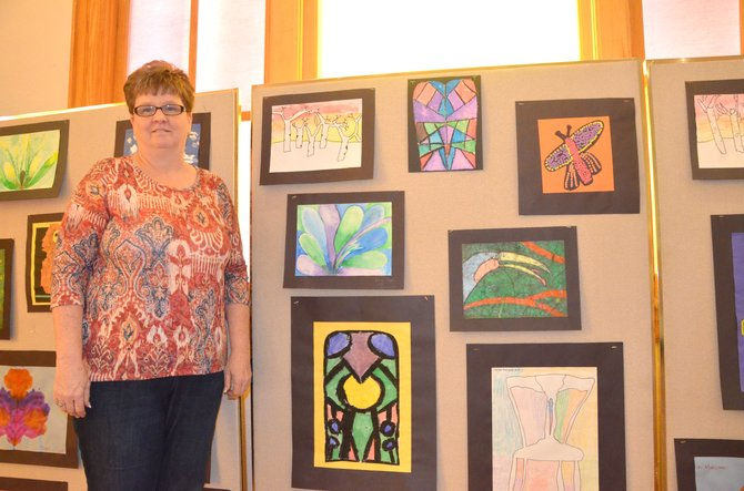 Betsy Overton displays the many artworks created by local children in the third annual Cherish the Little Things art show. Overton is the coordinator for Connections 4 Kids, which provides resources and services to young children in Moffat and Rio Blanco counties.