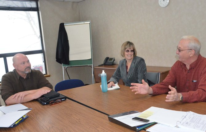 Members of the Craig Community Assessment subcommittee on economic development, from left, Steven Fulton, Kathy Powell-Case and Jay Oxley, discuss how to grow Craig's business sector.